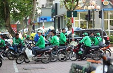 COVID-19 brings Hanoi GrabBike services to halt