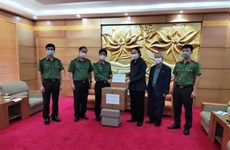 Medical masks presented to Laos-Vietnam friendship assoc