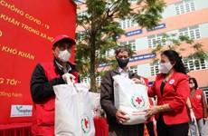 Six sites distributing free food helping Hanoi's poor