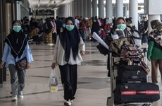 Indonesia cuts tourist arrivals target more than half due to COVID-19
