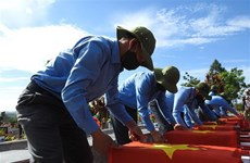 Remains of volunteer soldiers reburied in Dak Lak
