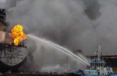 Fire breaks out on oil tanker at Indonesian port