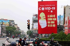 Russian expert: Posters a weapon in Vietnam's COVID-19 fight
