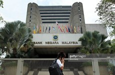 Malaysia reduces interest rates to record low