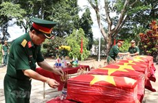 Remains of 10 martyrs reburied in Dak Nong