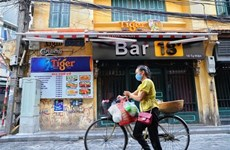 Hanoi orders closure of bars, karaoke venues and roadside stalls
