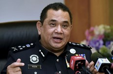 Malaysia detains two network attack suspects