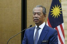 Malaysia PM self-quarantines, Philippines reopens public schools