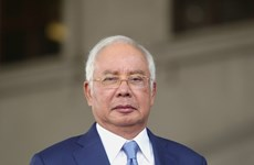 Malaysia postpones former PM's 1MDB trial