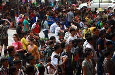 Thailand urges migrant workers to renew work permits
