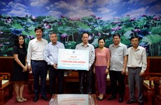 Funds raised by PetroVietnam to support flood victims, poor people