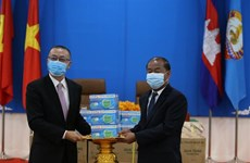 Face masks presented to Cambodian People's Party