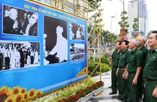 Photo exhibition features Vietnam Fatherland Front's 90-year operation