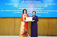 "Cuban Ambassador receives ""For peace and friendship among nations"" insignia"