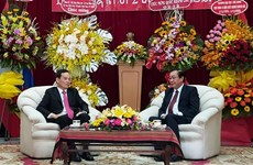 HCM City leaders offer greetings on Laos' 45th National Day