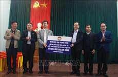 Front working delegation grants gifts to flood-affected people in Quang Binh