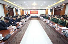 Session highlights special links between Vietnamese, Lao armies