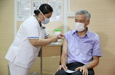 Singapore: PM receives COVID-19 vaccine as nationwide vaccination drive begins