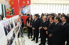 Photo exhibition held to celebrate 13th National Party Congress