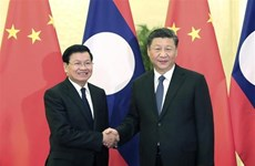 Chinese, Lao leaders seek to boost bilateral relations through phone talks