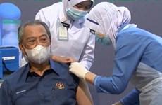 Malaysia begins national COVID-19 immunisation