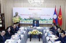 Outcomes of Lao People's Revolutionary Party's 11th National Congress informed to Vietnam