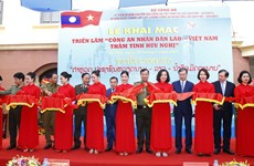 Exhibition spotlights friendship of Vietnamese, Lao public security forces