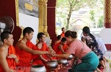 Laos bans public events over traditional New Year