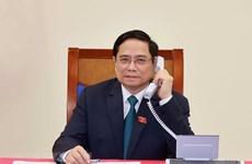 Lao Prime Minister makes phone call to congratulate Vietnamese counterpart