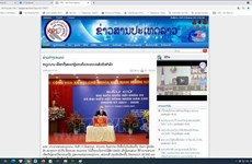 Lao newspapers spotlight success of Vietnam's general elections