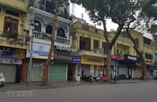 Hanoi shuts down on-site restaurants, hair salons