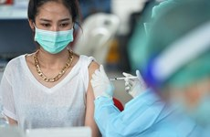 Thailand fears COVID-19 risk from East, Laos boosts screening of arrivals