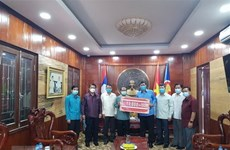 Laos joins hands with Vietnam to fight COVID-19