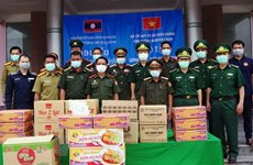 Food, medical supplies presented to border forces in Lao province