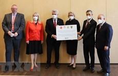 German states present COVID-19 rapid test kits to Vietnam