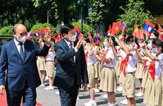 Top Lao leader's visit to Vietnam grabs Lao headlines