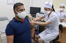 Fifty foreign reporters in Vietnam get vaccinated against COVID-19