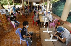 COVID-19 cases continue to drop in Cambodia, Malaysia speeds up vaccinations