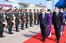 President Nguyen Xuan Phuc arrives in Vientiane