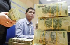 Reference exchange rate down 26 VND on August 12