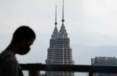 COVID-19 darkens Malaysia's 2021 economic outlook