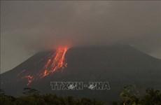 Indonesia's Merapi volcano erupts, spewing ash