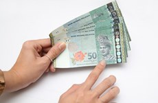 Malaysia's ringgit falls to lowest in a year