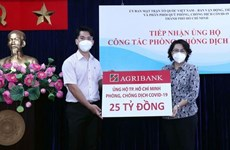 MIC launches programme to support COVID-19 hit people in HCM City