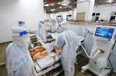 Vietnam logs additional 14,224 COVID-19 cases
