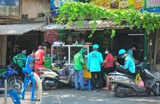 COVID-19: Hanoi permits motorbike shippers to operate from 9am to 8pm