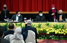 Malaysian government and opposition Pakatan Harapan ink 'historic' MOU
