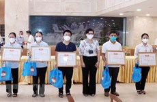 HCM City honours Catholic volunteers for COVID-19 control