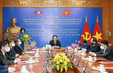 Vietnamese, Lao parties review theoretical exchange