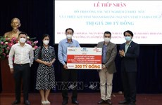 HCM City receives over 200 million VND from businesses for COVID-19 fight